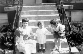 On the stoop with my two younger sisters